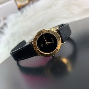 Gucci gold and black vintage Swiss made 3000 watch